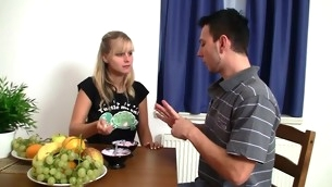 Breasty blond playgirl bows over the table and gets drilled enduring