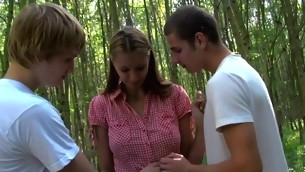 Two dudes start banging a horny golden-haired's twat cleft outdoors